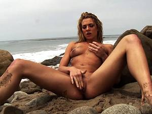 Bailey Blue squirting by the sea