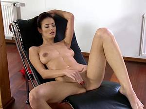 Silvia undresses then slips in two fingers