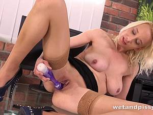Sensational Sabina toys her supple pussy until she pees
